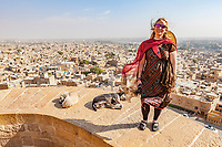 A Caucasian female traveler atop the walls of Jaisalmer Fort, Jaisalmer, Rajasthan, India.