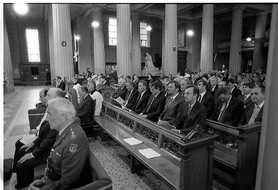 Mass For The 26th Dail.     (T3)..1989..29.06.1989..06.29.1989..29th June 1989..After the General Election  a mass took place today at the Pro-Cathedral in Dublin. The mass was to bless   the incoming TD's who were successful in their election to the Dáil...The new government TD's are pictured sitting on the left of the church as the mass is said in the Pro-Cathedral.