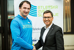 Primoz Kozmus and Roman Dobnikar, new president of AZS during press conference when Slovenian athletes and their coaches sign contracts with Athletic federation of Slovenia for year 2016, on February 25, 2016 in AZS, Ljubljana, Slovenia. Photo by Vid Ponikvar / Sportida