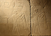 Tomb relief: Men harvesting in the presence of Hetepet (left) 6th dynasty 2360-2195 BC.