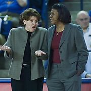 Delaware Women's Head Coach Tina Martin (Left) and George Mason Women's Head Coach Jeri Porter (Right) having a conversation prior to the start of NCAA college basketball game between George Mason and Delaware Thursday, Feb. 23, 2012, at the Bob Carpenter Center in Newark, Del. (AP Photo/Saquan Stimpson)