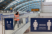 With the UK's Coronavirus pandemic lockdown easing with preparations going ahead for the opening of more public transport and services plus shops, another 151 have died from Covid-19 bringing the total in the last 24hrs to 41,279. An employer at Waterloo Station disinfects surfaces in the station concourse, on 11th June 2020, in London, England.
