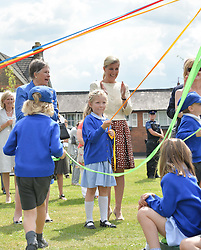 HRH the Countess of Wessex visits the Riverhill Regeneration project in Cobham Surrey on 9th July 2014.<br /> Picture shows:-The COUNTESS OF WESSEX watches local children dancing around a Maypole.
