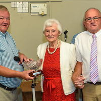 Kinsale Regatta chairman Teddy McNamara makes a presentation to 95 yr old Aggie Ford from Greenwich, London pictured with her nephew Charles Henderson from Kinsale at the Kinsale Regatta Emigrants' Welcome Home gathering at Temperance Hall.<br /> Picture. John Allen