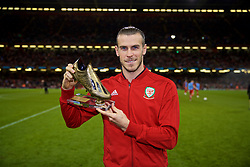 CARDIFF, WALES - Thursday, October 11, 2018: Wales' record men's goal scorer Gareth Bale is presented with a golden boot during the International Friendly match between Wales and Spain at the Principality Stadium. (Pic by David Rawcliffe/Propaganda)