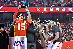 Jan 19, 2020; Kansas City, Missouri, USA; Kansas City Chiefs quarterback Patrick Mahomes (15) and tight end Travis Kelce (87) celebrates with the Lamar Hunt Trophy after beating the Tennessee Titans in the AFC Championship Game at Arrowhead Stadium. Mandatory Credit: Denny Medley-USA TODAY Sports
