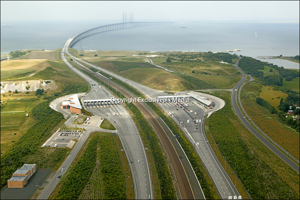 This Amazing Bridge Turns Into An Underwater Tunnel Connecting Denmark And Sweden<br /> <br /> This unique roadway connects the Danish capital of Copenhagen to the Swedish city of Malmö. The Øresund, designed by the Danish architect George K.S. Rotne, was opened on July 1, 2000. The bridge stretches about 8km before transitioning through an artificial island into a 4km tunnel under the Flint Channel.<br /> The site is interesting both biologically and architecturally: the Lund's Botanical Association has identified more than 500 different species of plants on the island, which was constructed from material dredged from the seabed. Most of the concrete tunnel was cast on land and towed out to the location.<br /> ©Exclusivepix Media