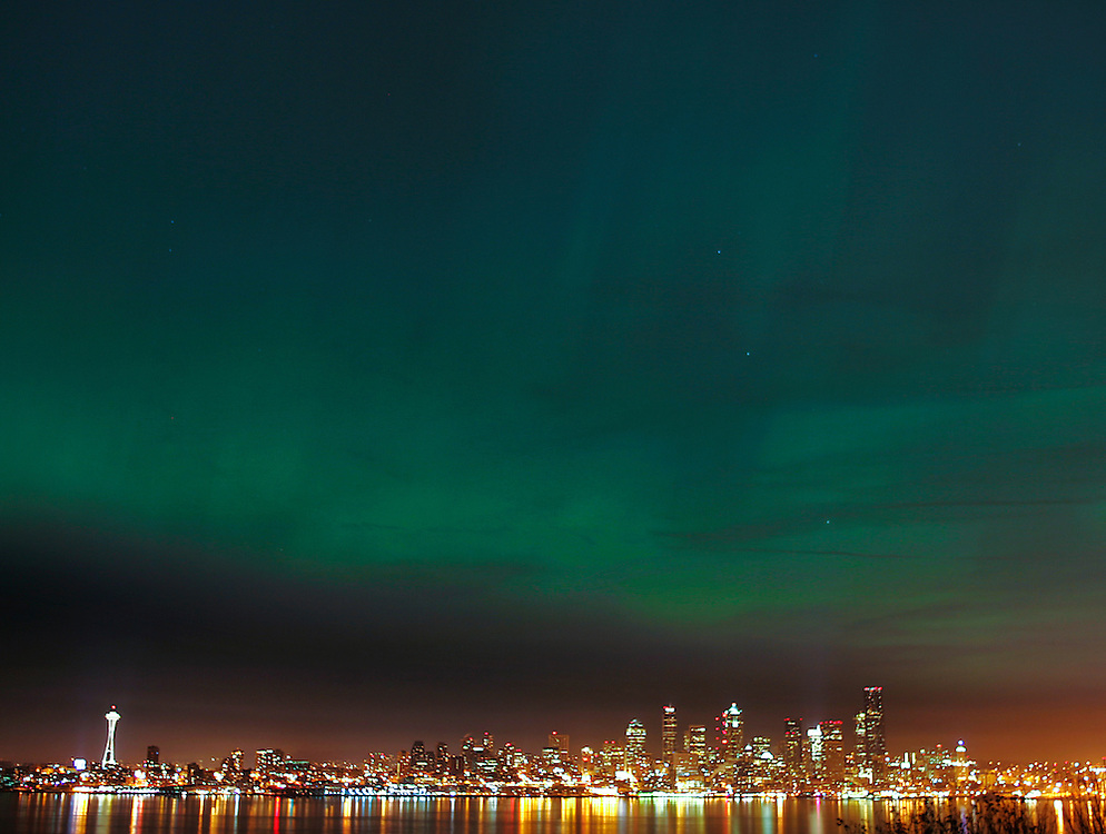 The Northern Lights shimmer across the Seattle skyline as seen from Hamilton Viewpoint in West Seattle. The rare phenomenon took place as an extreme geomagnetic storm raged in the upper atmosphere, sending high-energy particles emitted by the sun sweeping over Earth, making the aurora borealis visible as far south as Oklahoma.