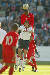 OSLO, NORWAY - Thursday, May 27, 2004:  Wales' Daniel Gabbidon and Norway's Ole Gunnar Solskjaer during the International Friendly match at the Ullevaal Stadium, Oslo, Norway. (Photo by David Rawcliffe/Propaganda)