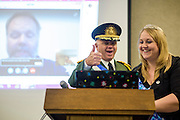 Anaheim , California - April 11, 2015: MicroCon's organizer, The Republic of Molossia's President, Kevin Baugh, and Molossia's first lady Adrianne Baugh shoot a hopeful thumbs up to His Holy Highness Yan the First of YAN who was supposed to speak about &quot;The Power Of One.&quot; Ultimately technical difficulties held sway. MicroCon 2015 is a Micronation conference held at the Anaheim Central Library.<br /> CREDIT: Matt Roth