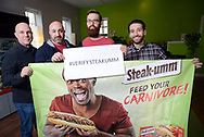 From left, Jesse Bender, Account Manager, Joey Piazza, Director of Marketing for Quaker Made Meats, Nathan Allebach, Social Media Manager, and Christian Betlyon, Digital Strategist, hold a Steak-umm marketing piece and a #verifysteakumm sign at Allebach Communications Tuesday December 19, 2017 in Souderton, Pennsylvania. The Montgomery County marketing firm is trying to have the Steam Twitter account verified with viral success. (WILLIAM THOMAS CAIN / For The Philadelphia Inquirer)