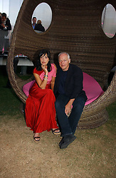 DAVID GILMOUR and POLLY SAMPSON at the Serpentine Gallery Summer party sponsored by Yves Saint Laurent held at the Serpentine Gallery, Kensington Gardens, London W2 on 11th July 2006.<br />