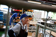 Hiroko Yoshimura (foreground of pic, 76 years old, in 9th year of working for Kato company) is an elderly worker at Kato (a light industry company) in Nakatsugawa, Japan, Monday 21st June 2010. Kato company has a workforce of 100 people, 50% of whom are 60 years of age or older. The elderly work force earn JPN ¥800-1,000 per hour, but receive no annual bonus or pay rise.