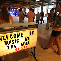"Tupelo residents arrive for ""Music at the Mill"" to kick off the Elvis Festival Thursday night. This is the Tupelo Cotton Mill's first event that featured all Mississippi-native singers/bands."