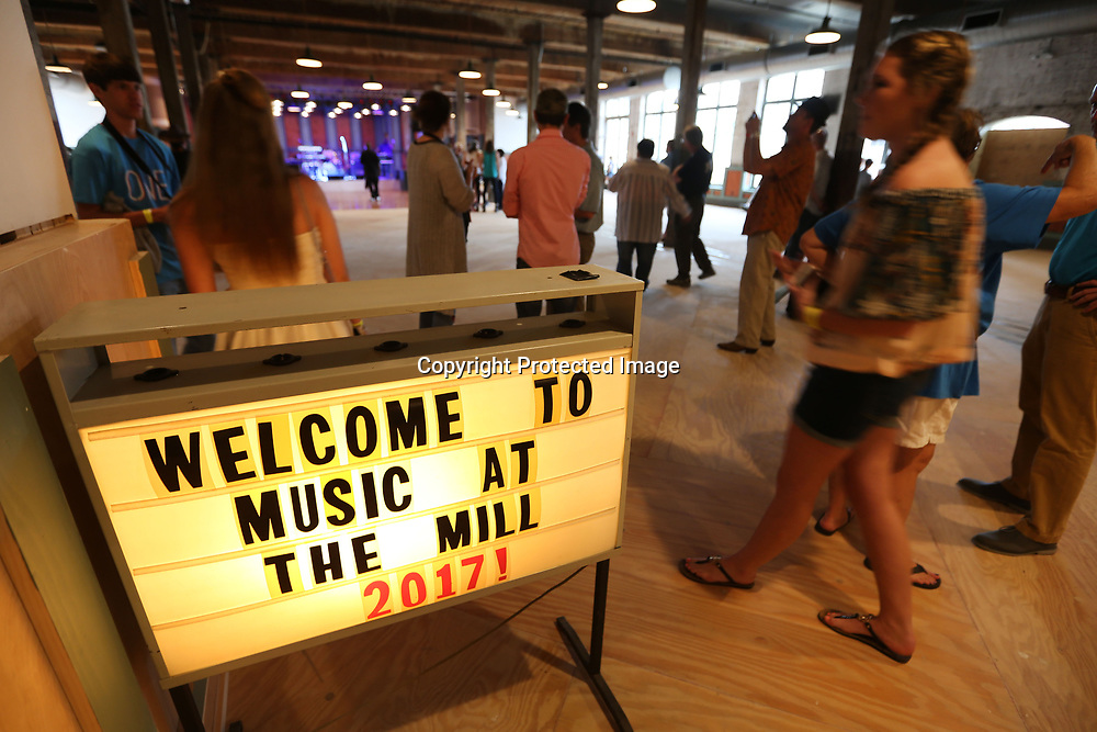 """Tupelo residents arrive for """"Music at the Mill"""" to kick off the Elvis Festival Thursday night. This is the Tupelo Cotton Mill's first event that featured all Mississippi-native singers/bands."""