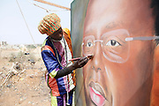 Rasta artist completes a painting of Senegal's President since April 2nd 2012 - Macky Sall. Dakar the capital of Senegal...Picture by Zute Lightfoot .+44(0)75145390425