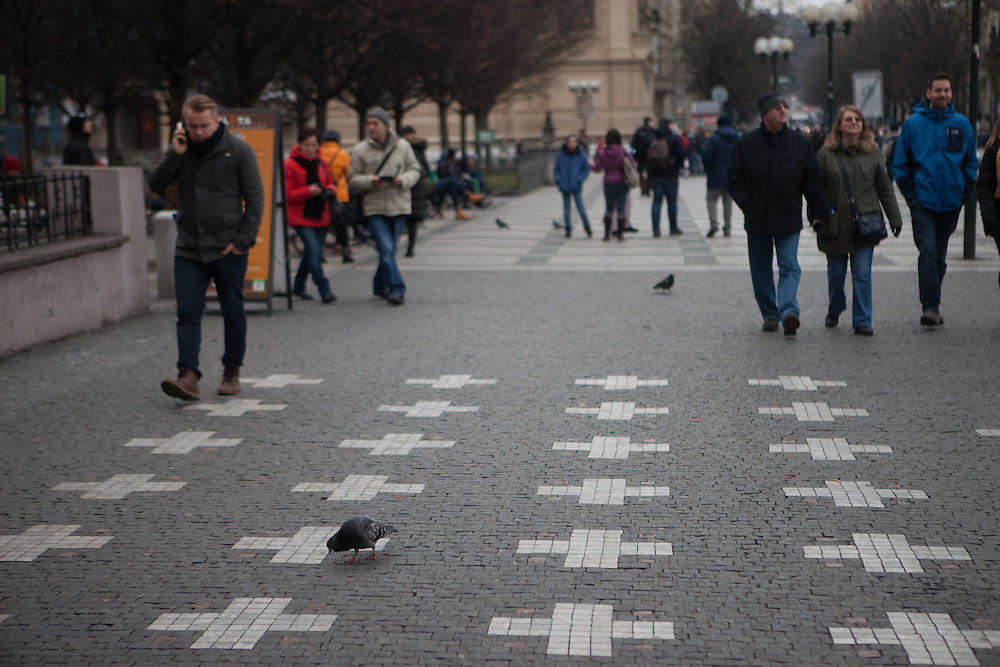 Old Town Square  is also home to a memorial to martyrs (including Jan Jesenius and Maxmilián Hošťálek) beheaded on that spot during the Old Town Square execution after the Battle of White Mountain. Twenty-seven crosses mark the pavement in their honour. While the installation date of these crosses is uncertain, a nearby plaque which lists the names of all 27 victims dates from 1911.