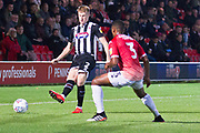 Grimsby Town defender Luke Hendrie pass the ball to Grimsby Town midfielder Elliott Whitehouse (not in the picture) during the EFL Sky Bet League 2 match between Salford City and Grimsby Town FC at Moor Lane, Salford, United Kingdom on 17 September 2019.