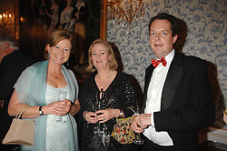 Left to right, SARA CAYZER, LADY CELESTRIA NOEL and WILLY DAVIS at a pub style quiz night in aid of Rapt at Willaim Kent House, The Ritz, London on 25th June 2006.  The questions were composed by Judith Keppel and the winning team won £1000 to donate to a charity of their choice.<br /><br />NON EXCLUSIVE - WORLD RIGHTS