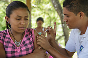 A health worker vaccinates a pregnant woman against tetanus during a vaccination session at the primary school in the town of Coyolito, Honduras on Wednesday April 24, 2013.