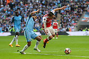 Arsenal's Héctor Bellerín(24) is tackled by Manchester City's Gaël Clichy(22) during the The FA Cup match between Arsenal and Manchester City at Wembley Stadium, London, England on 23 April 2017. Photo by Shane Healey.