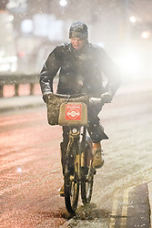 © Licensed to London News Pictures. 01/02/2019. London, UK. A commuters rides a bike through heavy snowfall in Maida Vale, West London as large parts of the UK are deluged with snow and freeing temperatures. Photo credit: Ben Cawthra/LNP