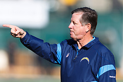 Jan 1, 2012; Oakland, CA, USA; San Diego Chargers head coach Norv Turner watches his team warm up before the game against the Oakland Raiders at O.co Coliseum. Mandatory Credit: Jason O. Watson-US PRESSWIRE