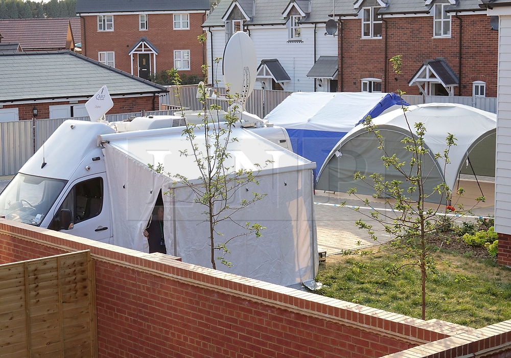 © Licensed to London News Pictures. 04/07/2018. Amesbury, UK. Tents erected outside a property in Muggleton Road, Amesbury where a couple, named locally as Dawn Sturgess, 44, and her partner Charlie Rowley, 45, were taken ill on Saturday 30th June 2018. Police have confirmed that the couple have been in contact with Novichok nerve agent. Former Russian spy Sergei Skripal and his daughter Yulia were poisoned with Novichok nerve agent in nearby Salisbury in March 2018.Photo credit: Peter Macdiarmid/LNP