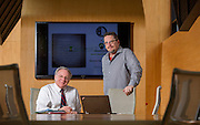 Bo Morton and Brent Robinson pose for a photo in a conference room on Tuesday, March 10, 2015, in Fayetteville, Ark..