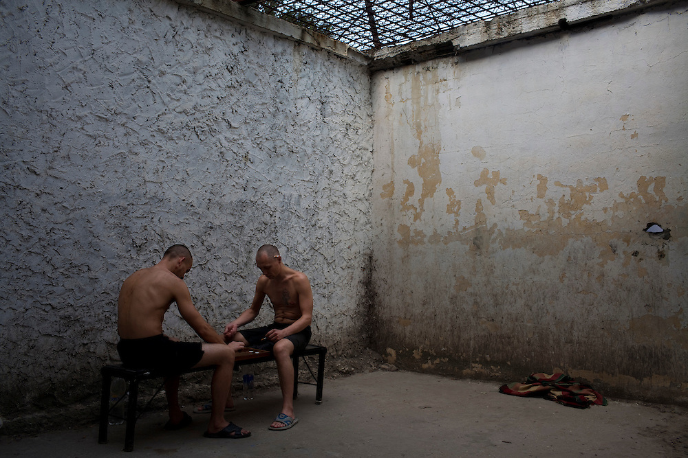 Two prisoners with TB play chess in an isolated area at the jail in Chisinau.