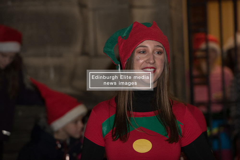 Edinburgh council may have cut the budget for Christmas street lights in various Edinburgh communities but the people of Portobello didn't let that dampen their spirits last night as they celebrated turning on the Christmas Tree lightsin front of Portobello Town Hall.<br /> &copy; Jon Davey/ EEm Edinburgh council may have cut the budget for Christmas street lights in various Edinburgh communities but the people of Portobello didn't let that dampen their spirits last night as they celebrated turning on the Christmas Tree lights in front of Portobello Town Hall.<br />