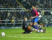 Photo Aidan Ellis.<br />Newcastle united v Barcelona (UEFA Champions League)<br />19/03/03.<br />Barcelona's patrick Kluivert scores after titus Bramble mistake