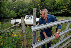 10/1/08 Richard Rhyne checks on the cattle at least twice a day, with his dog, Sarge, riding in the back of the truck. Today they have 76 head of cattle and hay crops. L.MUELLER/The Charlotte Observer