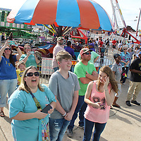 People at the Amory Railroad Festival's carnival laugh at their friends' and family members' reaction while on the high-flying Moby Dick ride.