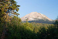Mt. Lassen peeks through a clearing near Manzanita Lake, Lassen National Park, California