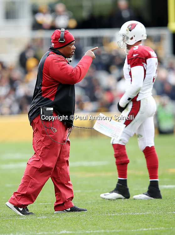 Arizona Cardinals offensive coordinator Harold Goodwin points from near the sideline during the 2015 NFL week 6 regular season football game against the Pittsburgh Steelers on Sunday, Oct. 18, 2015 in Pittsburgh. The Steelers won the game 25-13. (©Paul Anthony Spinelli)