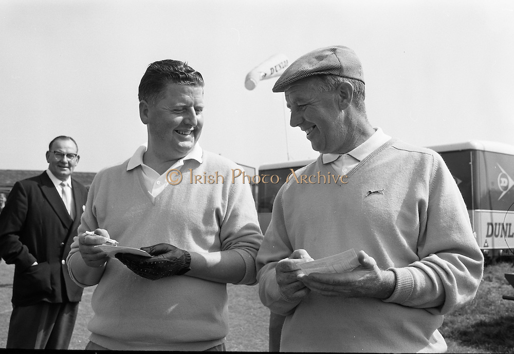 20/08/1967<br /> 08/20/1967<br /> 20 August 1967<br /> Irish Dunlop &pound;1,000 Tournament at Tramore Golf Club, Co. Waterford. Norman Drew (left) of Bradshaws Brae and Christy Greene of Miltown coming off the 18th green at the close of the competition.