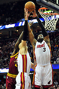 Dec. 2, 2010; Cleveland, OH, USA;  Miami Heat center Zydrunas Ilgauskas (11) and shooting guard Dwyane Wade (3) fight for a rebound with Cleveland Cavaliers power forward J.J. Hickson (21) during the first quarter of the game at Quicken Loans Arena. Mandatory Credit: Jason Miller-US PRESSWIRE