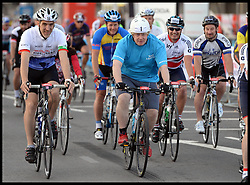 The Mayor of London Boris Johnson sets off from the Olympic Park on his Ride London bike ride, a 100 mile cycle ride, London, United Kingdom<br /> Sunday, 4th August 2013<br /> Picture by Andrew Parsons / i-Images