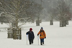 Walkers dress for cold weather in Corsham Park following overnight snow in north Wiltshire, Corsham, UK, January 18 2013. Photo by Mark Chappell / i-Images.