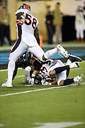 Denver Broncos strong safety T.J. Ward (43) recovers a fumble at the Carolina Panthers 4 yard line after Denver Broncos outside linebacker Von Miller (58) strips the ball out of the hands of Carolina Panthers quarterback Cam Newton (1), setting up the game winning score during the NFL Super Bowl 50 football game against the Carolina Panthers on Sunday, Feb. 7, 2016 in Santa Clara, Calif. The Broncos won the game 24-10. (©Paul Anthony Spinelli)
