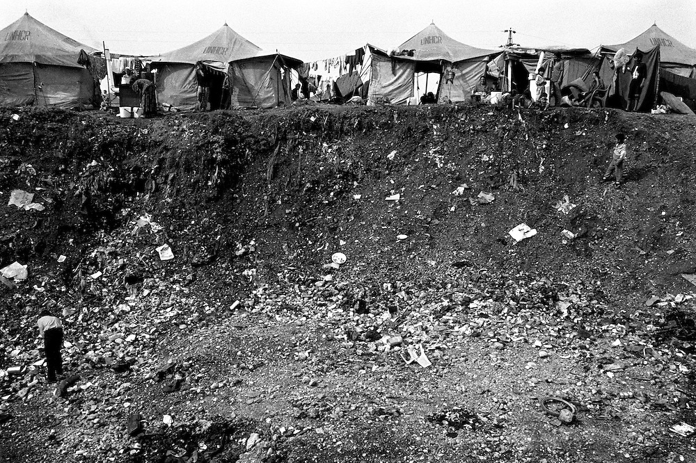 The camp was set up as the people arrived, by the people themselves, it was one big mess. It is on the outskirts of Podgorica, Montenegro's capital, on land the locals use as a mini garbage dump (within a few hundred meters of the municipality garbage dump). In December 1999 in the cold of the winter, the tents were exchanged for barracks, but the camp remains in the same place. ..Konik camp - a refugee camp for Roma (gypsies) displaced from Kosovo, Montenegro.