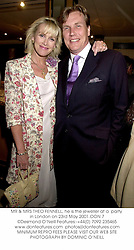 MR & MRS THEO FENNELL, he is the jeweller at a  party in London on 23rd May 2001.OON 7