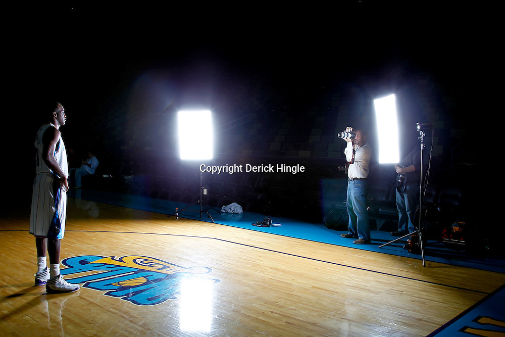 December 14, 2011; New Orleans, LA, USA; AP photographer Gerald Herbert shoots a portrait of New Orleans Hornets guard Quincy Pondexter (20) during Media Day at the New Orleans Arena.   Mandatory Credit: Derick E. Hingle-US PRESSWIRE