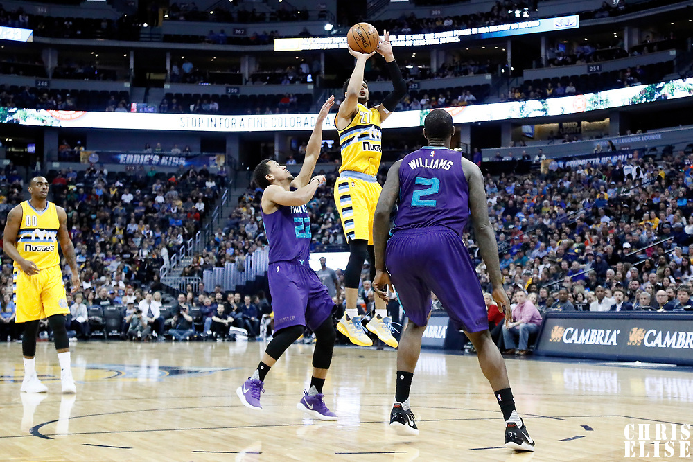 04 March 2017: Denver Nuggets guard Jamal Murray (27) takes a jump shot over Charlotte Hornets guard Brian Roberts (22) and Charlotte Hornets forward Marvin Williams (2) during the Charlotte Hornets 112-102 victory over the Denver Nuggets, at the Pepsi Center, Denver, Colorado, USA.