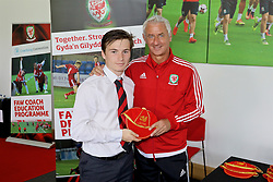 NEWPORT, WALES - Sunday, May 28, 2017: Harri Hughes receives a cap from Elite Performance Director Ian Rush for participation during day three of the Football Association of Wales' National Coaches Conference 2017 at Dragon Park. (Pic by Mark Roberts/Propaganda)