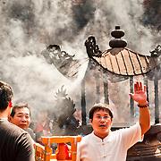 Taoist Priest uses Divining Chair, Taitian Temple of Nankunshen, Kun Chiang Village, Beimen Township, Tainan County, Taiwan
