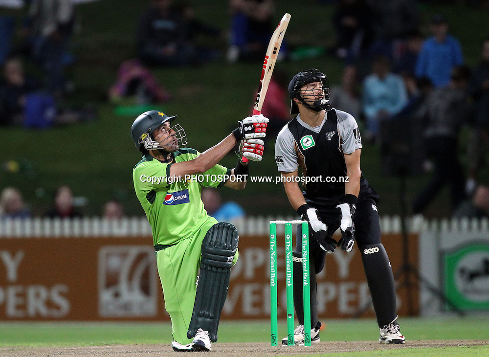 Umar Gul batting as Peter McGlashan looks on. New Zealand Black Caps v Pakistan, Match 2. Twenty 20 Cricket match at Seddon Park, Hamilton, New Zealand. Tuesday 28 December 2010. Photo: Andrew Cornaga/photosport.co.nz
