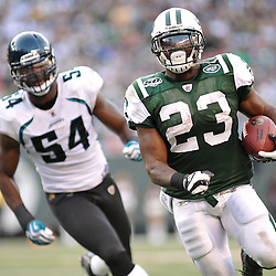 Nov 15, 2009; East Rutherford, NJ, USA; New York Jets running back Shonn Greene (23) outruns Jacksonville Jaguars defensive end Quentin Groves (54) during second half NFL action in the Jacksonville Jaguars 24-22 victory over the New York Jets at Giants Stadium.