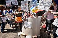 Roma 18 Giugno 2015<br /> Manifestazione degli Animalisti Italiani,  vicino all'ambasciata della Cina, per protestare  contro il  Festival di Yulin che si terrà il 21 giugno. Yulin è una metropoli cinese di 5 milioni e mezzo di abitanti, dove il 21 giugno di ogni anno, per il solstizio d'estate, si celebra un Festival per il quale vengono macellati e poi mangiati circa 10mila cani. Rappresentazione degli attivisti di Animalisti Italiani  che hanno messo in scena quello che avviene nei giorni del Festival: cani e gatti torturati e bolliti vivi, dopo essere stati catturati per strada o sottratti ai loro padroni.<br /> Rome June 18, 2015<br /> Animal rights activists demonstrated, near the Embassy of China, to protest against the Festival of Yulin to be held on June 21. Yulin is a Chinese metropolis of 5 million and a half inhabitants, where on June 21 of each year, for the summer solstice, is celebrated a festival for which are then slaughtered and eaten about 10 thousand dogs.<br /> Representation Animal rights activists, who have staged what happens during the festival: dogs and cats tortured and boiled alive, after being captured in the street or taken from their masters.